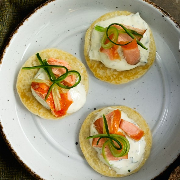 Smoked salmon blinis with tzatziki good housekeeping for Salmon canape ideas
